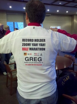"2012 Zoom! Yah! Yah! Indoor Marathon: Greg wearing his ""Half Marathon Record Holder"" shirt"
