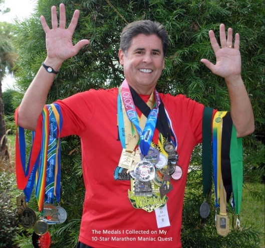 Greg with his medals representing the 30 marathons that he ran in 30 different states and countries in 12 months to earn his 10 Star Marathon Maniac status
